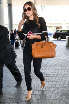 She's got a lot of front: Fearless Elizabeth Hurley was turning heads yet again after flas...