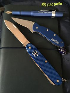 Kaweco Al Sport in Blue, Kershaw Scallion with Bkue scales, Victorinox Farmer in Blue Alox, Midori TN in Pan Am Blue, and Pacsafe Messenger bag in Blue