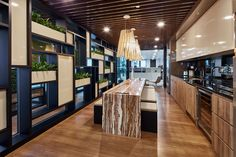 Bringing nature inside to create a soothing aura with green surroundings, for a inspiring, supportive workplace that exudes the company's team ethos to create a sense of belonging for staff Work Cafe, Green Walls, Pantry, Singapore, Spaces, Create, Nature, Table, Furniture