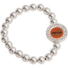 Ladies, bring your Cowboys game day outfit full circle with a touch of class and shine when you wear this Round Crystal Beaded bracelet featuring an acrylic team logo inlay surrounded by sparkling rhinestone accents on a stretch band comprised of silvertone beads!