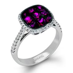 Simon Set Collection - This gorgeous 18K white and black gold ring is comprised of .30ctw round white Diamonds and  1.61ctw princess cut Rubies.  - MR2243 Words cannot describe its beauty.  Try it on today at SVS Fine Jewelry 2947 Long Beach Rd. Oceanside NY 11572 or call (516) 766-2614 for more details.