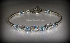 Wedding Bracelet - Light Sapphire Aurora Borealis Bridesmaid Bangle Bracelet. $29.99, via Etsy.