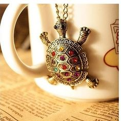 Retro Turtle Necklace is very cute and has colorful crystals inlaid on his shell. Great for everyday wear. Long chain is great for any style top: tshirts, sweaters, or of course turtlenecks! Great gif