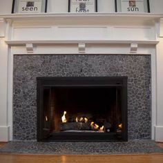 Pebble tile sheets can cover ugly tile. Available in many styles. Fireplace in pic done for about $200