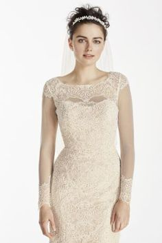 This lavish lace sheath dress is absolutely charming!  Classic form fitting lace sheath embellished with beaded lace and boatneck.  Featuring exquisite beaded lace detail on cuff of long illusion sleeves.  Chapel train. Sizes 0-14. Available in Ivory/Nude and Solid Ivory by special order only in stores and online.  Back buttons. Imported. Dry clean only.  Also available in Regular, Plus Size, Extra Length, and Extra Length Plus Size. Check your local stores for availability. Cherish your