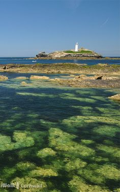 """Stones Reef and Godrevy Lighthouse, St Ives Bay, Cornwall.  You can guess what happened to shipping before the lighthouse was built.  It's no coincidence there are two beaches nearby called """"Dead Man's Cove"""" and one called """"Hell's Mouth""""."""