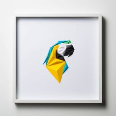 Istanbul-based paper artist Tayfun Tinmazleft a career in modeling to begin producing paper art designs, a practice of geometric-inspired works he collects under the name Paperpan. To produce each piece he first individually folds several dozen colorful triangles. Next, he fits these discrete parts