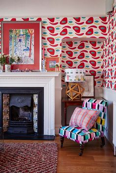 The reception room wows with Ottoline's Chief Clown wallpaper inspired by the Ballets Russes dance company.