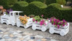You will love to make this easy DIY Crate Train Planter and it's perfect for showing off your favorite blooms. We've also included a video tutorial and lots of pretty pictures to show you how you can get the perfect look for your garden. Check out the Caterpillar version too!