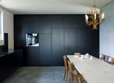 Lumbrien Home by Hurst Song Architects. Timber cladding and concrete slabs are the host to tiny details like the copper capped roof and joinery pulls./p