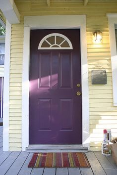 purple door, yellow house --my house has just this color siding. Once I get my living room repainted, my front door is next! Purple Front Doors, Purple Door, Front Door Colors, Front Door Decor, House Paint Exterior, Exterior House Colors, Feng Shui, Bungalow, Door Paint Colors