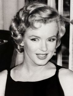 """Marilyn Monroe at a press conference for """"The Prince and The Showgirl"""" at the Savoy Hotel, London, July 1956."""