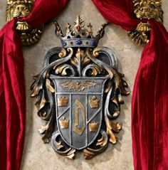 Created from historic drawings, this family crest of Vlad the Impaler heralds the vampire known as Count Dracula. Complete with a vampire bat and a regal crown, this Gothic work of wall art is cast in quality designer resin and hand-painted in a duo-tone pewter finish accented by blood red cabochons.