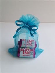 Organza bag filled with mini rolls of Love Hearts