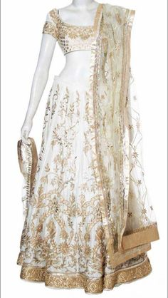 White lehenga with gold embroidery