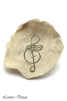 This pair of silver treble clef ear cuff is handmade by me using tarnish resistant colored copper wire. Due to the nature of handmade items, you may receive this ear cuff not exactly as pictured but will be very much close to the design.    These are great gift for families and friends.  Let me...