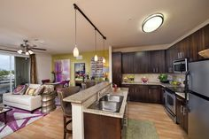 Spacious kitchen with real wood cabinets, granite counter tops, and stainless steel appliances Brown Granite Countertops, Concrete Countertops, Outdoor Kitchen Countertops, Granite Kitchen, Kitchen Appliances, Kitchen Counters, Basic Kitchen, Buy Kitchen, Outdoor Kitchen Design