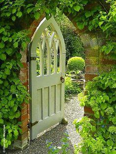 Gothic shaped painted garden doorway