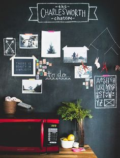 Cute chalkboard wall. Oh, could I have fun with this. Thought about designating one wall and using permanent marker. The chalkboard idea might be better.