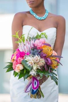 Still so in love with this wedding bouquet. Wedding Decor: Tropical Bouquet Ideas & Beachy Color Palette | Exquisite Weddings