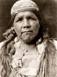Here for your browsing pleasure is an imposing photo of the Principal Female Shaman Hupa. It was made in 1923 by Edward S. Curtis.    The illustration documents a Hupa woman, head-and-shoulders portrait, facing front.    We have compiled this collection of artwork mainly to serve as a vital educational resource. Contact curator@old-picture.com.