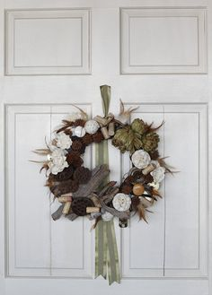 reDesign fun with dried artichokes, bark and lotus pods, a few corks and even some knobs from ReStore!  {designed by Kelly Acock}