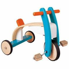 kinsley would love this wooden tricycle. cool retro colors