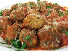 Meatballs  I made these to be added to tomato sauce to be served over pasta. You can also make these in smaller sized meatballs to be served as an appetizer.  1 1/2 lb ground beef 2 slices white b…