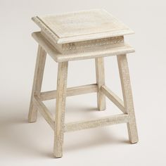 This little stool is long on style, hand painted with traditional Indian motifs and finished with whitewash for a vintage look.