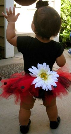 this is the type of outfit I want my baby girl to wear for her bday!! but a MUCH bigger tutu lol