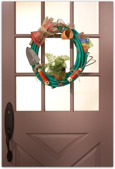 A Gardener's Wreath made from garden hose, pots, gloves, shovel, and trowel #diy #wreath | From The Home Depot Fall Style Guide 2012