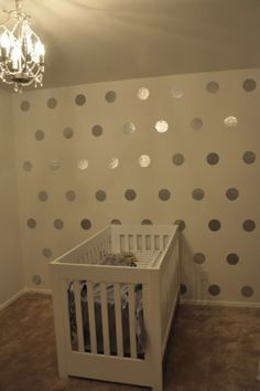 Neutral or light purple wall and metallic Polka Dots