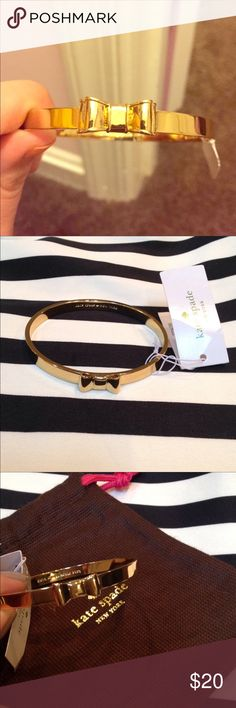 NWT Kate Spade Gold Idiom Bow Bangle Kate Spade bow bangle in gold, comes with original tags. It has been worn, but still in great condition!! 🎀 kate spade Jewelry Bracelets