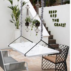Quirky white patio garden
