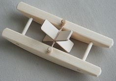 This cute, rubber band-powered Wooden Paddle Boat is one of our best-sellers! Handcrafted in Maine of native white pine, and hand-sanded to a satin smooth finish, these toy boats are eco-friendly bath