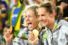 Gold medalists Laura Ludwig and Kira Walkenhorst of Germany celebrate on the podium during the medal ceremony for the Women's Beach Volleyball on day 12 of the Rio 2016 Olympic Games at the Beach Volleyball Arena on August 17, 2016 in Rio de Janeiro, Brazil.