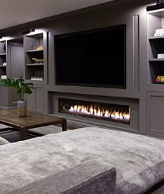 When it comes to outfitting the ground floor in your home, a basement fireplace will up the ante. We're talking instant warmth and ambiance. Here are eight basement fireplace ideas to inspire your decor. Basement Fireplace, Basement Living Rooms, Modern Basement, Fireplace Design, Fireplace Ideas, Basement Ceilings, Modern Tv Room, Cozy Basement, Low Ceilings