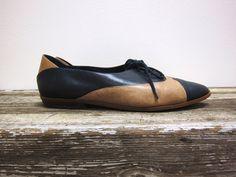 * For sale is a pair of vintage lace up oxfords with a delightful design navy and tan leather. These shoes are in great vintage condition. One