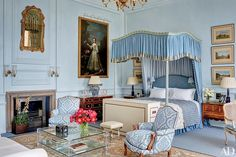 Designer Mark Gillette gave this four-story apartment in an English country estate a grand but comfortable feel. The master bedroom features a 17th-century Daniel de Coning portrait; the 18th-century four-poster is canopied with a Zoffany silk, the armchairs are upholstered in a Brunschwig & Fils fabric, and the blue carpeting is by Stark.