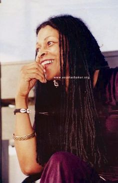 This is Assata Shakur, who is widely known as a member of The Black Panther Party and Black Liberation Army. She and fellow BLA member Zayd Malik Shakur were involved in a shooting, which left her wounded, her BLA brother dead, and one police officer dead. In prison, Assata was left in solitary confinement for months at a time and beaten almost to paralysis. She managed to escape in 1979, and in 1984, she was granted asylum in Cuba. The US government has a million dollar bounty on her head.
