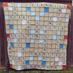 Scrabble Rag Quilt, what a cute idea!! This would be cute to do all the grand kids names for grandma! After they're all born of course!