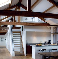 Cool concept for loft space just above kitchen. COuld be one on either side - one for home office and one for kids play