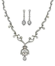 A SET OF ANTIQUE DIAMOND JEWELRY  Comprising a necklace, suspending an articulated pear-shaped diamond pendant from an old mine-cut diamond scrolling plaque, to the old mine-cut diamond sculpted neckchain; and a pair of ear pendants en suite, mounted in silver-topped gold, circa 1880, necklace 16¾ ins.