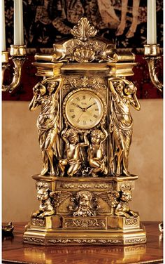 Features:  -Greek style.  -Roman numerals.  -Design Toscano exclusive.  -Quality designer resin construction.  -Antique faux gold finish.  Product Type: -Tabletop.  Time Display: -Analog. Dimensions: