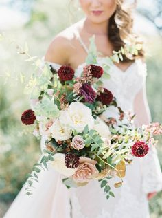 Crimson and blush wedding bouquet: http://www.stylemepretty.com/2017/03/21/the-dreamiest-alfresco-wedding-by-the-lake/ Photography: Maria Lamb - http://marialamb.co/