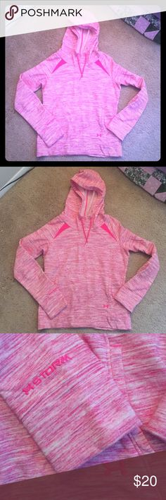 Under Armour Pink Hoodie This is an Under Armour pink Storm hoodie. Great condition! Only worn once! Has front pockets, no thumb holes. Under Armour Tops Sweatshirts & Hoodies