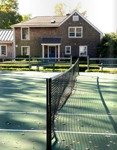 A tennis court for a front lawn? Yes please!
