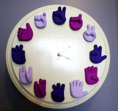 Must do this in fimo. Great way to teach time and ASL numbers!