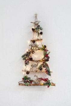 Wall Christmas Tree Could also be used to display a nativity scene Wall Christmas Tree, Hygge Christmas, Christmas Nativity, Christmas Home, Christmas Wreaths, Christmas Ornaments, Christmas Design, Christmas Colors, Rustic Christmas