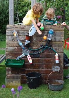 DIY Backyard Waterfall Water Wall for Kids: What a fun way to repurpose empty bottles!